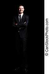 full growth. portrait of a confident smiling businessman -...