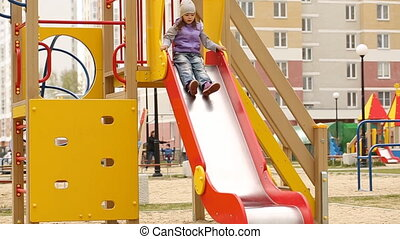 Little girl playing on the playground