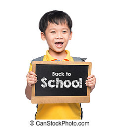 Young asian boy smile holding BACK TO SHCOOL chalkboard over white