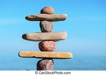 Stable stack stones - Balancing several of stones on the...