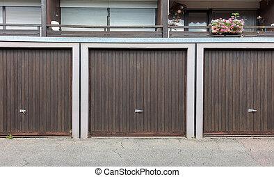 Old brown door of a garage, apartment complex