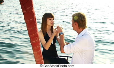 Romantic mood - Young couple relaxing on a yacht they were...