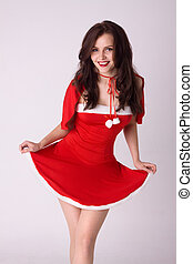 happy smiling woman in red xmas sexy costume