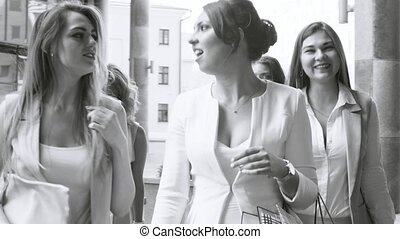 Partrait of business women walking and talking - Close up...