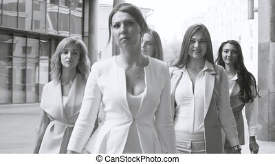 Portrait of business women walking in the city - Close up...