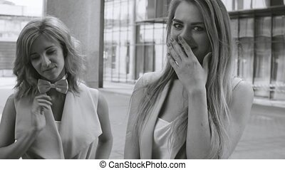 Attractive business women talking and laughing - Close up...