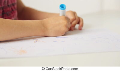 Child's hands with pencil