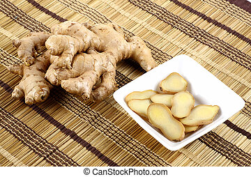 Ginger and Ginger pieces  - Ginger pieces on mat background