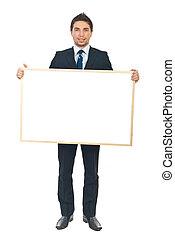Businessman holding blank banner - Full length of beauty...