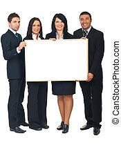 Four businesspeople with banner - Full length of four...