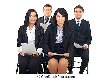 Business people at seminar - Four business people sitting on...