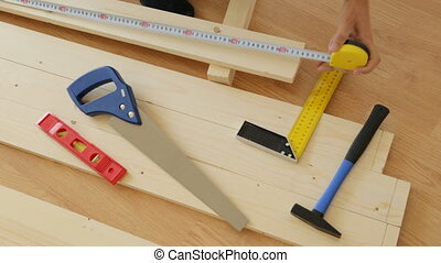Making slot rack with saw and tape measure