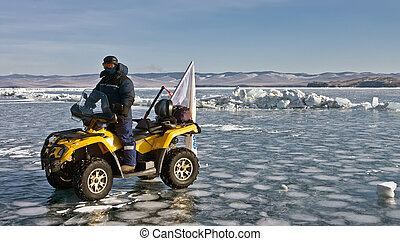 all-terrain vehicle On an ice of Baikal