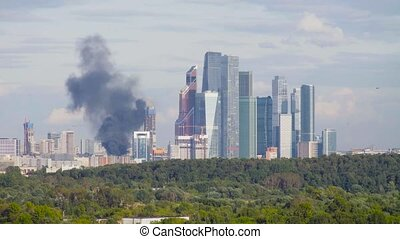 Black smoke over burning residential building - High angle...