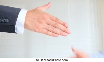A Business Handshake. Two men shake hands. 4k, slow-motion -...