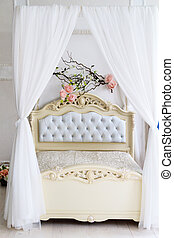 Large four-poster bed for newly married couples