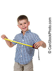 Young builder assistant in blue checkered shirt is happy to measure something with a measuring tape, white background.