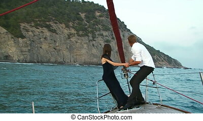 Fearless couple - Brave young couple sitting on the edge of...