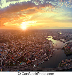 A big panorama of the city of Kiev on Podol at sunset. A...
