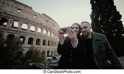 Happy traveling couple taking selfie photo on smartphone...