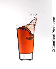 Splash in a glass of red lemonade