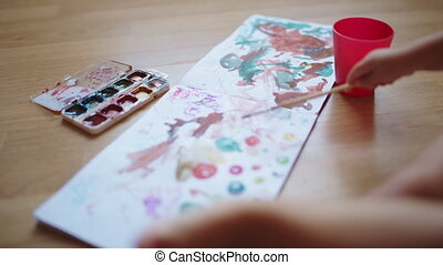 Painting with watercolors on paper. - Hands of little girls...