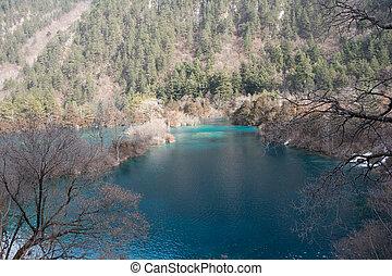 Lake Jiuzhaigou on a background of forest mountains
