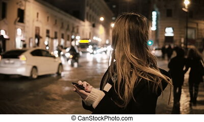 Young attractive woman walking in city centre, near the...