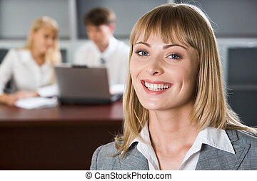 Smiling girl - Portrait of smiling blond Caucasian woman and...