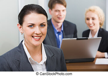 Pretty business woman - Young beautiful smiling woman in a...
