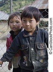 Black Hmong ethnic children - Children are often afraid of...