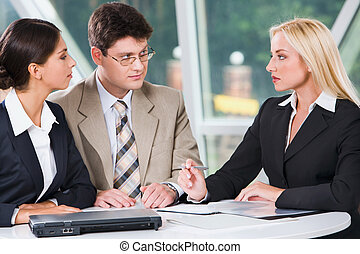Workgroup meeting - Three young professionals gathered...