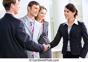 Business sale - Businessman and businesswoman shaking hands...