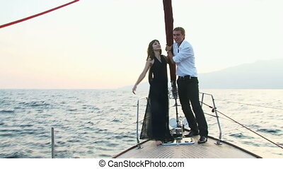 Adrenalin - A beautiful young couple standing on the edge of...
