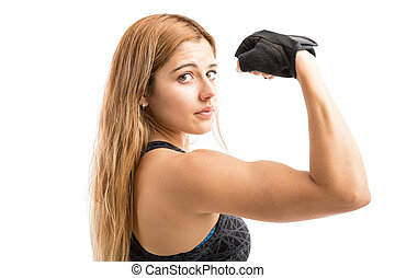 Athletic woman showing her strength - Attractive and fit...