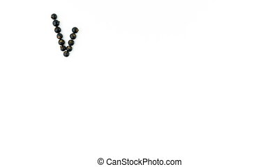 Vitamin C. Black currant berries on white background. 4K...