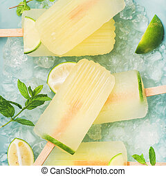 Summer lemonade popsicles with lime and chipped ice, square...