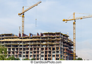 Crains on construction site of building