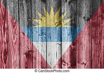 Flag of Antigua and Barbuda on weathered wood