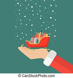 Santa claus hand holding sleigh containing a full of presents