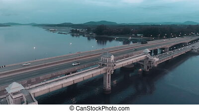 Aerial view of beautiful sea and bridge during sunset -...