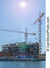 Construction Site Sunflare - An image of construction cranes...