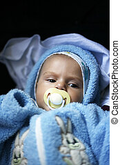 young child - The young child in a blue suit on a dark...