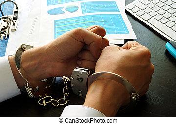 White collar crime concept. Businessman in handcuffs.