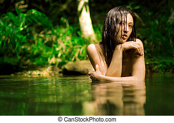 Nude bathing - Beautiful girl bathes nude in forest stream