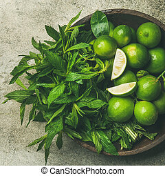 Flatlay of fresh limes and mint, top view, square crop -...