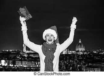 woman at Piazzale Michelangelo with Christmas gift rejoicing...
