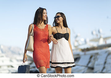 Best friends shopping and having fun in a bay