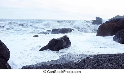 Iceland, surf on black beach. South coast, Vic - Iceland,...