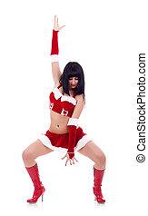 girl as Santa dances